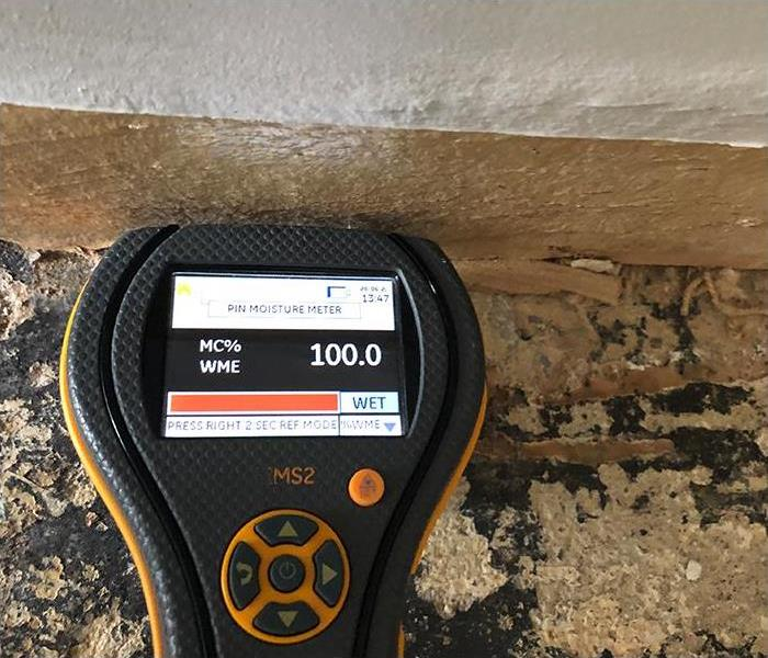 moisture reading during water damage inspection