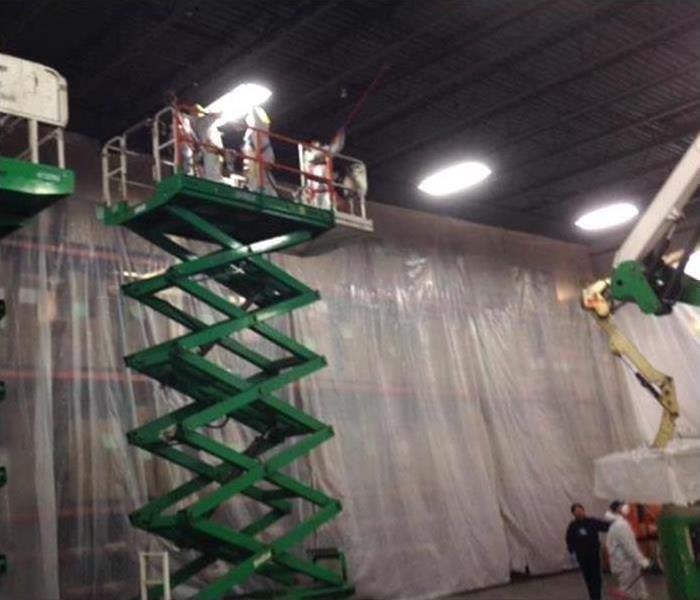 SERVPRO crews working on drying and cleaning commercial warehouse
