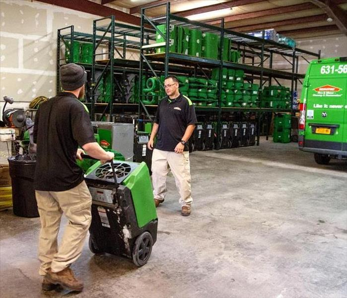 SERVPRO of Oakdale/North Bay Shore Team Loading Equipment