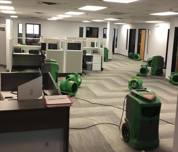 water damage to office shows restoration drying equipment