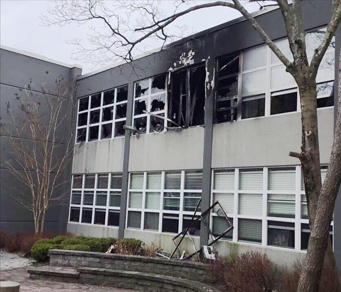 local school exterior after a property fire with broken windows and soot damage